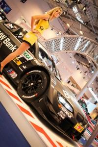 DTM-Girl mit dem Siegerfahrzeug BMW M3 DTM von Bruno Spengler zur Essen Motor Show 2012